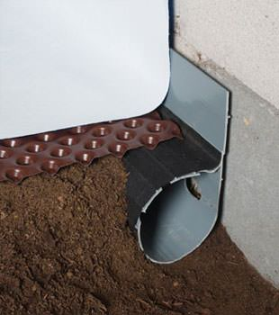 Closeup of a crawl space drainage system installed in Julian