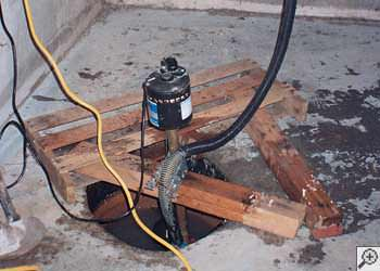 A Reynoldsville sump pump system that failed and lead to a basement flood.