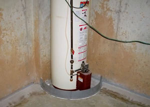 A water heater in Curwensville that's been protected by the FloodRing® and a perimeter drain system.