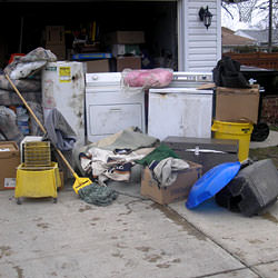 Soaked, wet personal items sitting in a driveway, including a washer and dryer in Port Matilda.