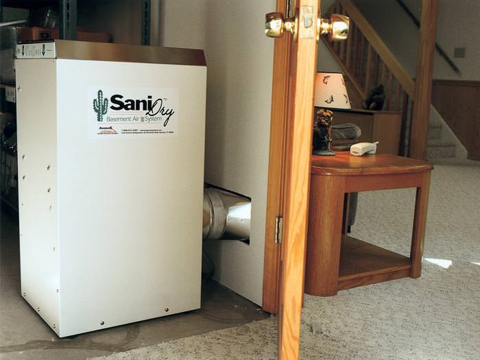 A Basement Dehumidifier With An ENERGY STAR® Rating Ducting Dry Air Into A  Finished Area