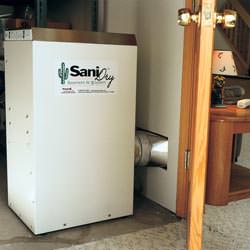 A basement dehumidifier with an ENERGY STAR® rating ducting dry air into a finished area of the basement  in Cherry Tree