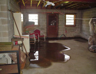 a flooded basement floor in a Cherry Tree home