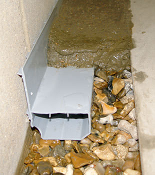 A basement drain system installed in a Port Matilda home
