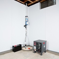 Sump pump system, dehumidifier, and basement wall panels installed during a sump pump installation in Philipsburg