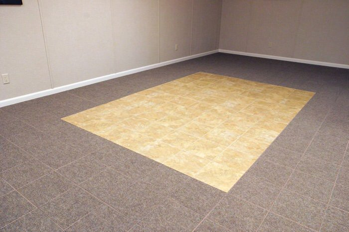 tiled and carpeted basement flooring installed in a Du Bois home